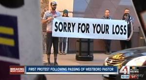"he ""Sorry For Your Loss"" sign at Fred ""God Hates Fags"" Phelps funeral changed me forever"